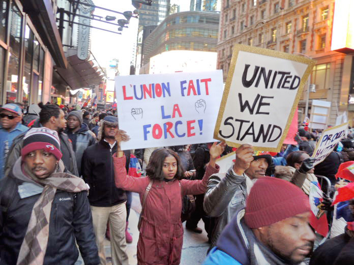Haitians demonstrating in New York City against Trump's insults.