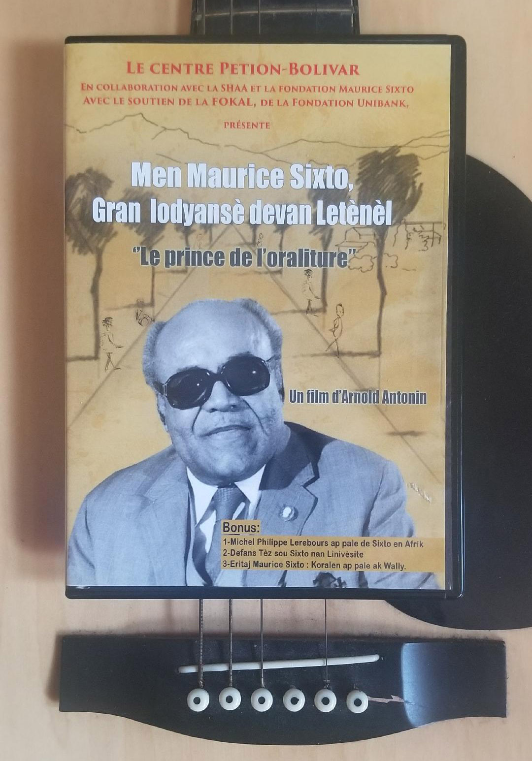 "Reproduction of the DVD cover entitled ""Here's Maurice Sixto: The Great Eternal Front Luminous""."