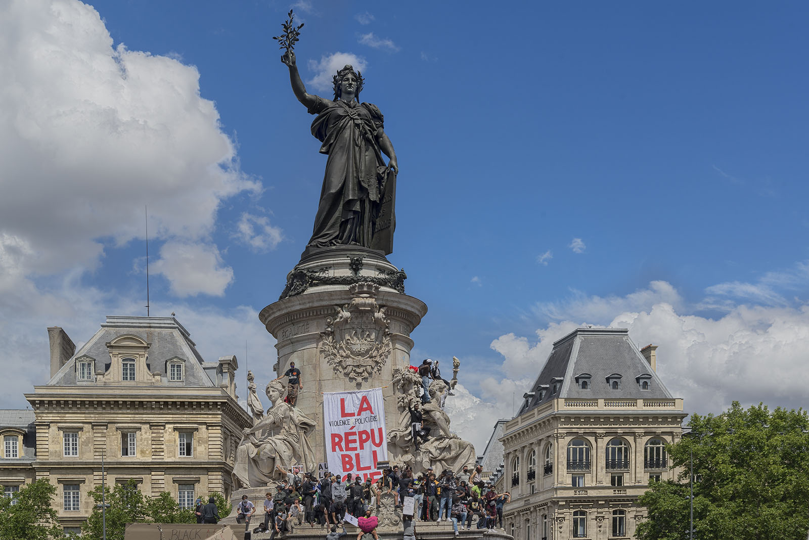 Demonstrators on the statue of Marianne, the national mascot of France in place de la République on Saturday June 13th 2020, commemorating George Floyd's execution and the murder of Adam Traoré.